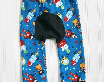 Baby's organic Maxaloones Grow With Me Pants.  Robots, astronauts on royal blue background. Ready to ship.