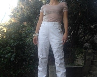 """Katharine Hamnet White Jeans Katherine Hamnet is well known for her famous large bold print shirts such as """"SAVE THE WHALES"""""""