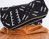 Black mudcloth and leather clutch handbag