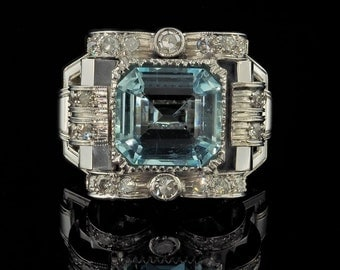 An original Art Deco 5.20 Ct aquamarine and diamond buckle ring