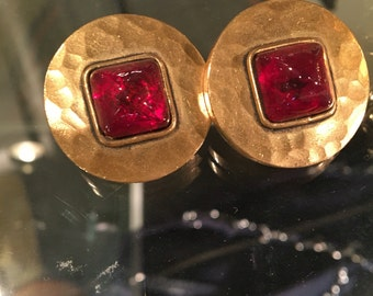 Vintage Chanel earrings in thick textured gilt with red glass cabochon