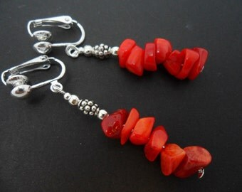 A pair of pretty red coral chips dangly clip on earrings.