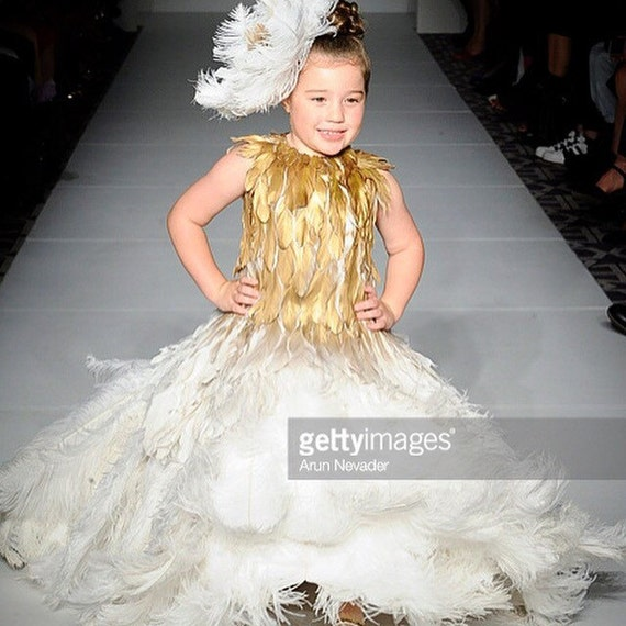 IRINA SHABAYEVA KIDS couture (inspired  by Misty Copeland's) Feather Queen Elizabeth dress with gold leafed bodice .