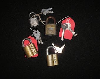 4 vintage padlocks with keys