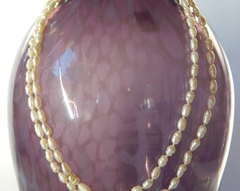 "Mother's Day Gift: Fresh-water pearl strand, 20"" long.  Can wrap around neck twice"