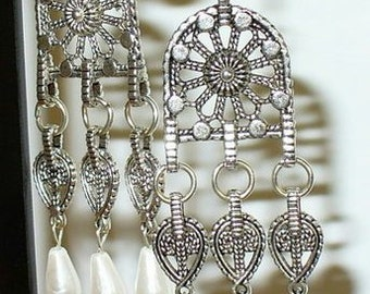 Long earrings with white glass drops