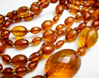 "Faceted Victorian Honey Amber Beads, Largest beads Almost 1"", Opera Length 49"", Hand Knotted Silk, c.1890, Germany.."