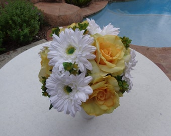 Bridal bouquet designed with open roses and gerber daises
