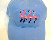 Four Flamingos on a Blue ...