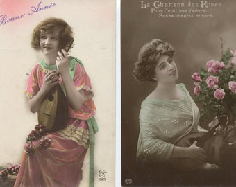 Seven French postcards showing women with mandolins, guitars, ca. 1910