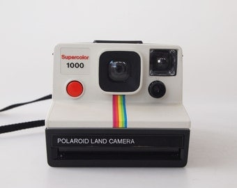 White Polaroid Supercolor 1000 Land Camera with rainbow stripes