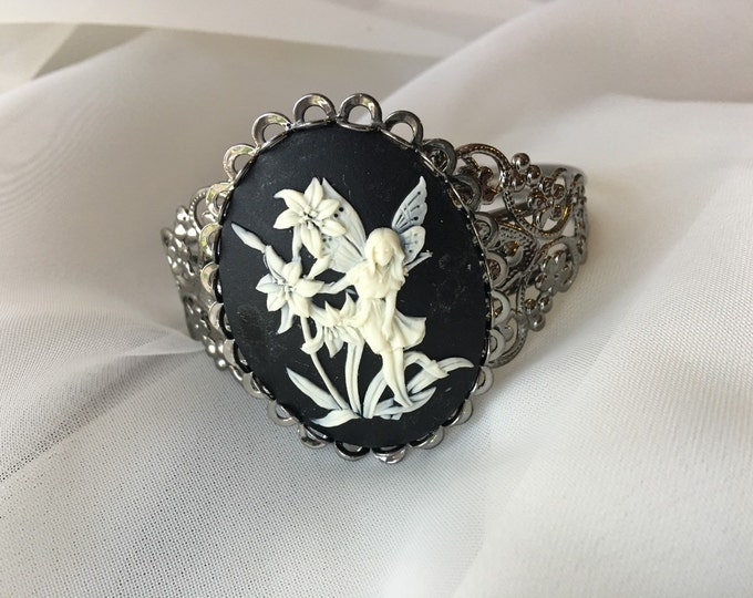 Gunmetal cuff bracelet with a Fairy cameo in black and white.