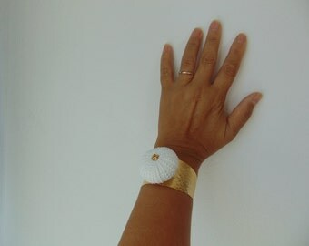 An  adjustable sea urchin gold- plated  bracelet,  real sea treasure.