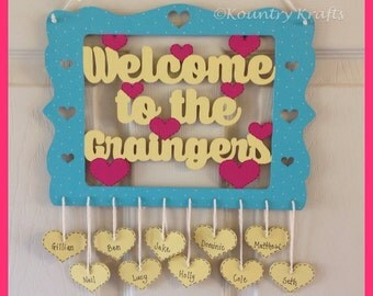 Welcome To The Surname Wooden Hanging Sign with Personalised Hanging Hearts