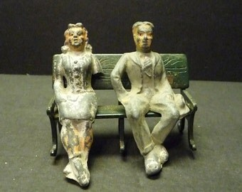 Vintage Man and Woman on Bench Lead Toy