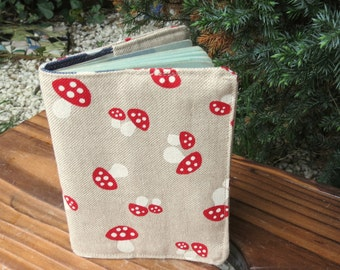 A passport sleeve with a whimsical toadstool design.  Passport cover.