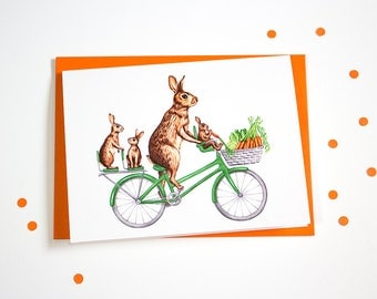 Rabbits family on bicycle card