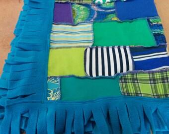 Blue baby blanket/shawl with fun fleece fringe.