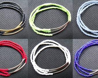 Altogether 3 tube bracelets gold or silver
