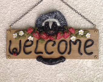Skunk and strawberries welcome sign