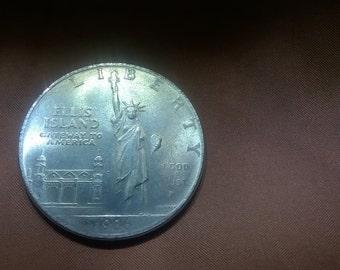 Lot of four 1906 Ellis Island Replica collectible coins.