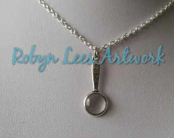 Small Silver Magnifying Glass Style Charm Necklace on Silver Crossed Chain or Black Faux Suede Cord with Glass