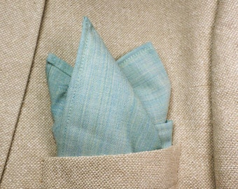 Pocket square in pure English worsted tropical wool in heathered seafoam aqua, turquoise and mint colorway.