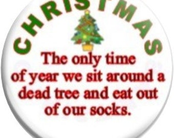 Eat out of our Socks. Item  FD40-13  - 1.25 inch Metal Pin back Button or Magnet