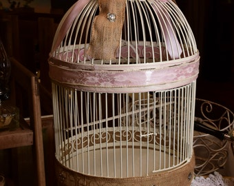 Large Bird cage with pale pink ribbon and burlap