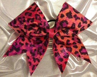 Pink and orange leopard print cheer bow