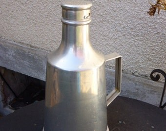 aluminum bottle with stopper duster , original and vintage . kitchen decoration