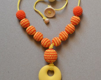 "Teething sling necklace ""Orange honey"""