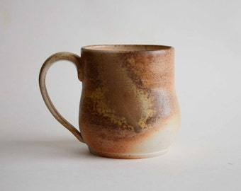 Wood fired ceramic mug - wheel thrown fired in wood kiln with naturally occurring variation in appearance