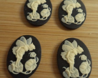 25mm x 18mm oval resin cameos of a fairy looking at a ladybug ivory on black 4 pc lot