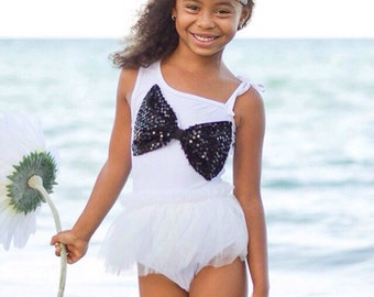 White girls monokini with black sparkle bow and tutu. Stylish swimwear. 4th of july, pageant