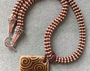 Beaded necklace with ceramic pendant