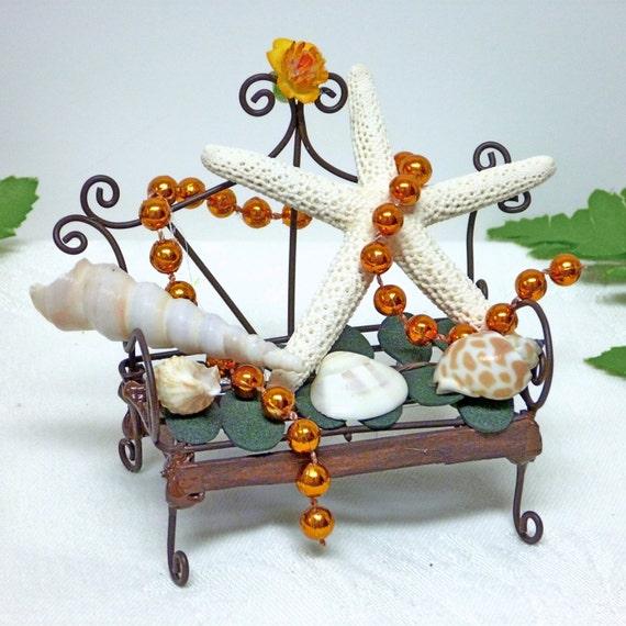 Kust de bench tuin bench met schelpen parels een - Tuinmodellen met rollen ...