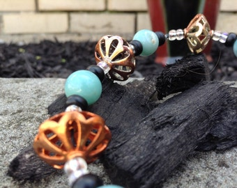 Onyx and emerald copper bracelet