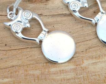 Solid silver owl drop earrings