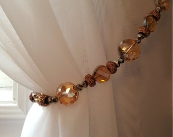 Beaded Drapery Tie-back with amber & slate coloured beads (gorgeous combo!), on copper wire.  Light-catching and stunning.