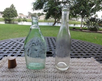 Lot of 2 vintage glass bottles Old Colony Soda PA and a green tint liquor bottle