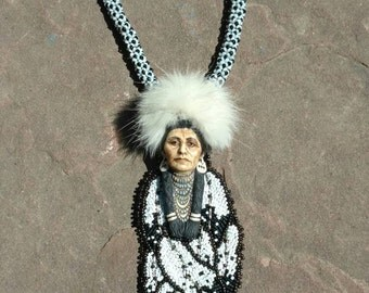 Eagle feathers warrior native American inspired beadwork jewelry by Beadworkdreamsraven. Laura mears cabochon