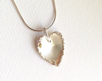 Silver heart pendant with granulation decoration.