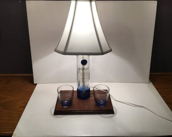 Beautiful Blue Ciroc Bottle Lamp with Shade, Oak Base, and Two Blue Ciroc Glasses