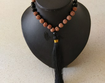 Handmade seed and crystal bead with tassle necklace.