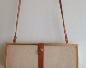 Vintage sleeve bag with leather