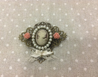 Lady cameo, with romantic airs and vintage brooch.