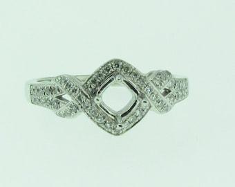 14 K white gold diamond engagement setting.