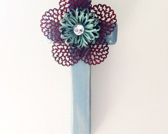 Rustic blue wooden wall cross with metal flower