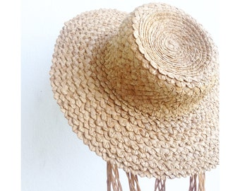 the vintage hand woven straw hat . vintage straw hat